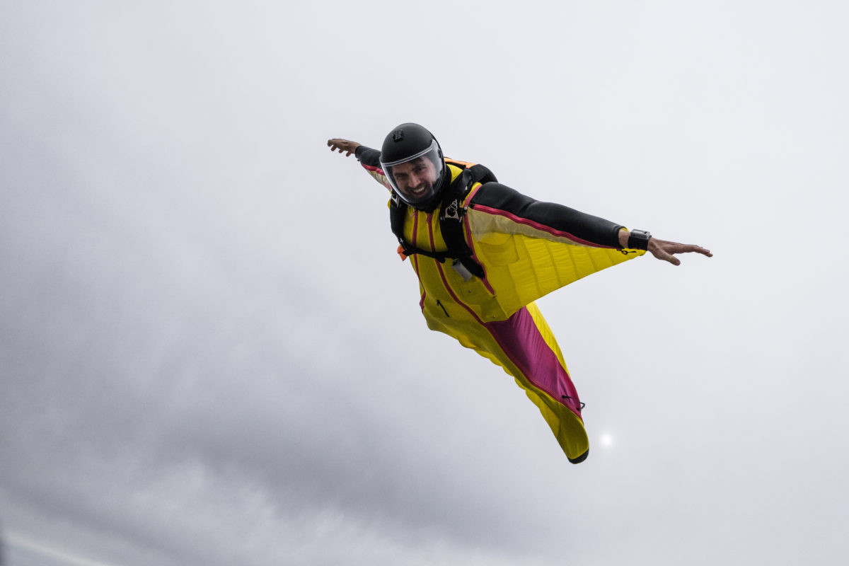 A skydiver learning to wingusit